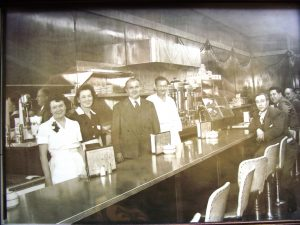 Black and white photo of staff and customers at the Band Box restaurant