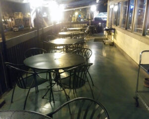 Jake and Telly's Patio tables at night