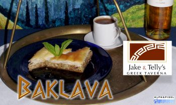 "Dessert at Jake and Telly's, Close up of Baklava on a blue plate and Greek coffee in a white demitasse cup. Both are on a brass serving tray. ""Baklava"" is written in gold Ancient Greek style letters and a Red Jake and Telly's logo on the Right of the photo. tha AlphaPixel Reach logo is in the lower right hand corner"