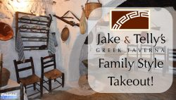 Family Style Takeout image. Jake and Telly's logo overlaid on a rustic Greek village house with tables and chairs.