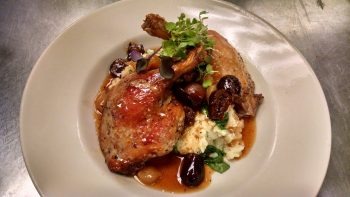 Jake and Telly's Specials - Close up image of Roast Duck on a white plate with Greek olives, mashed potatoes and green garnish