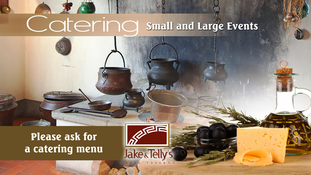 Photo ad for Jake and Telly's Catering, small and large events, please ask for a catering menu. Photo featuring cast iron pot belly pots in an antique Greek Kitchen with images of Olive oil, cheese, black olives and fresh rosemary branches