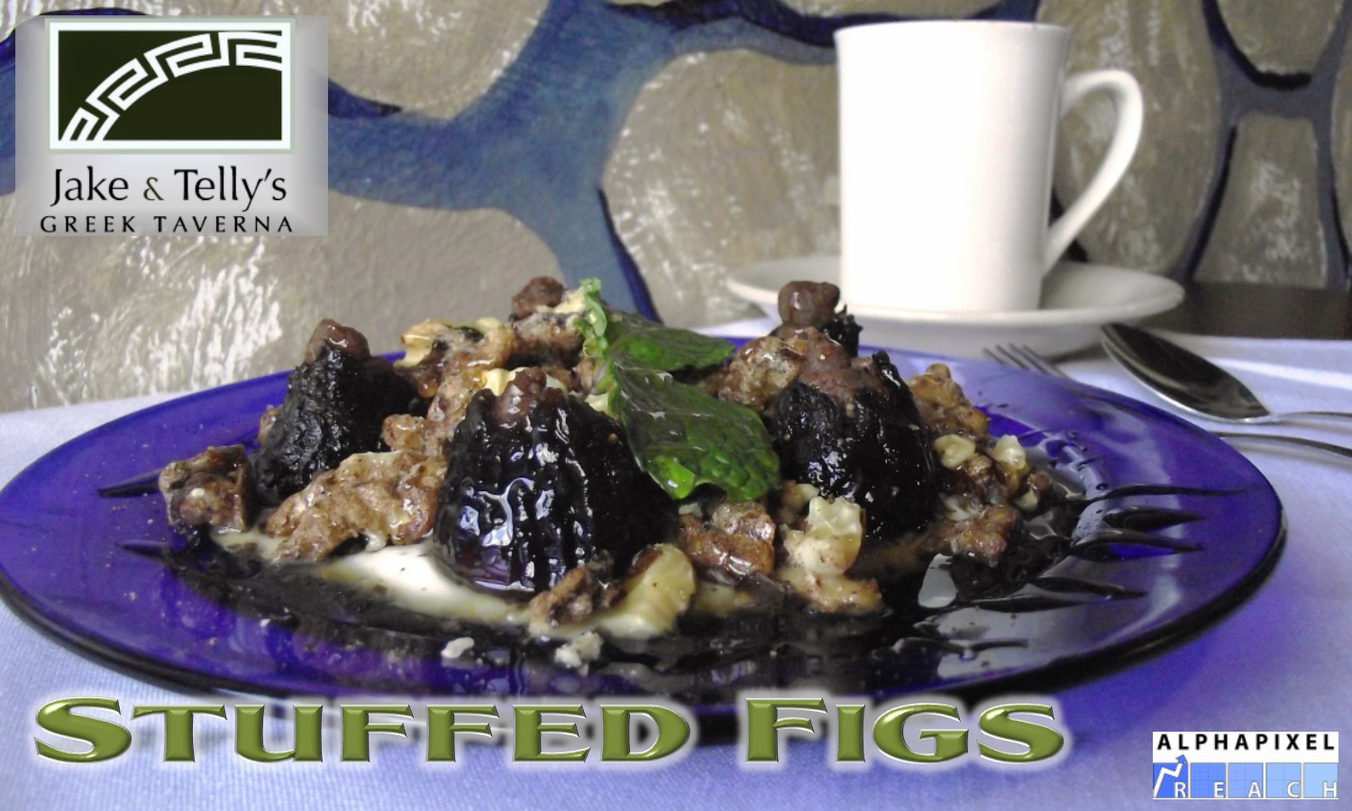 """Dessert at Jake and Telly's, Stuffed Figs: A photograph of a blue plate of Stuffed Figs on a white tablecloth with a cup of coffee and a fork and spoon visible behind them. The figs are stuffed with cinnamon, vanilla, and crushed walnuts then topped with Greek yogurt and honey. A Green Jake and Telly's logo is in the upper left hand corner and the text """"Stuffed Figs"""" is present beneath the plate. The AlphaPixel Reach logo is in the lower right hand corner."""