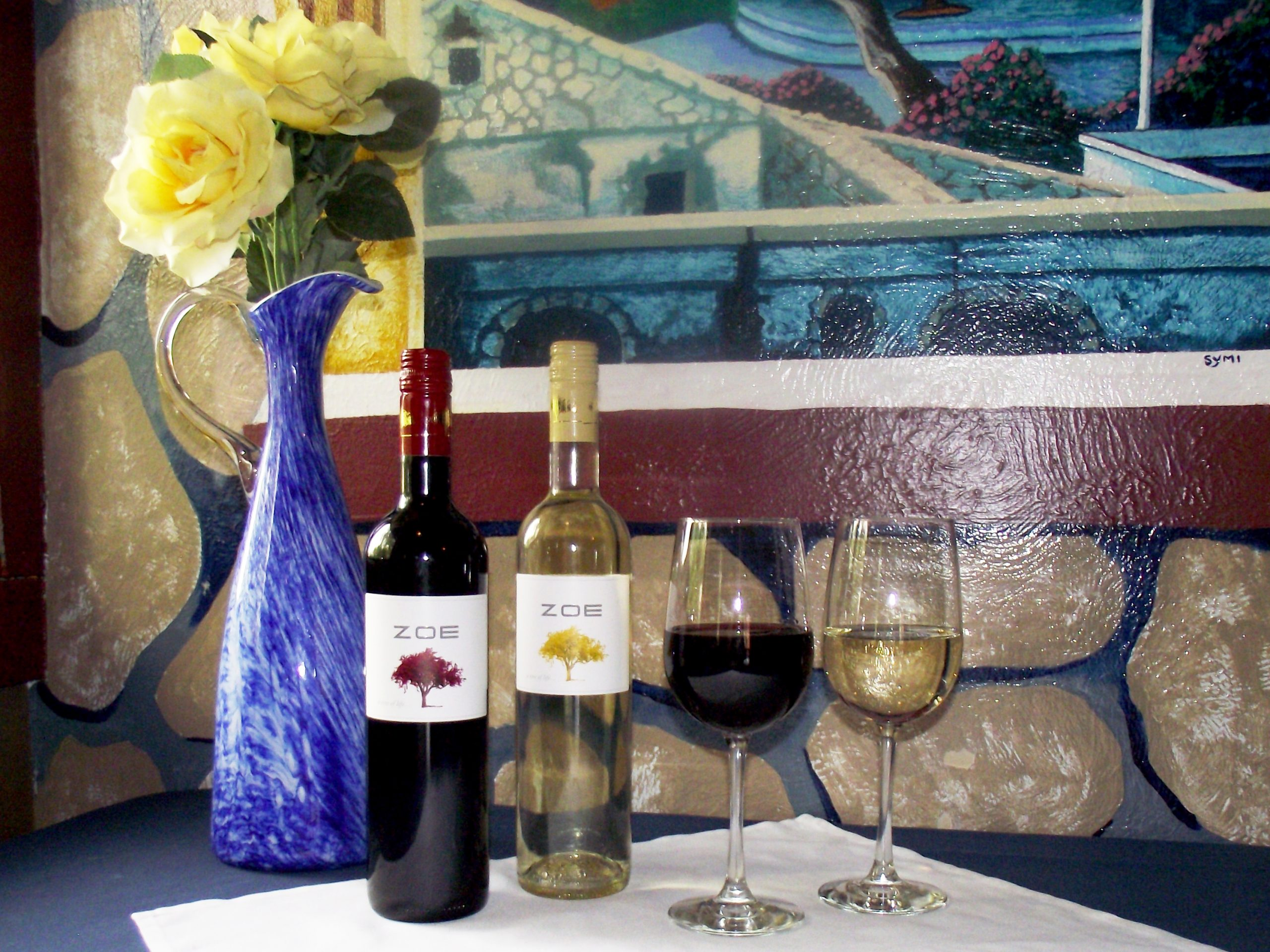 ZOE Red and White wines with a glass of each
